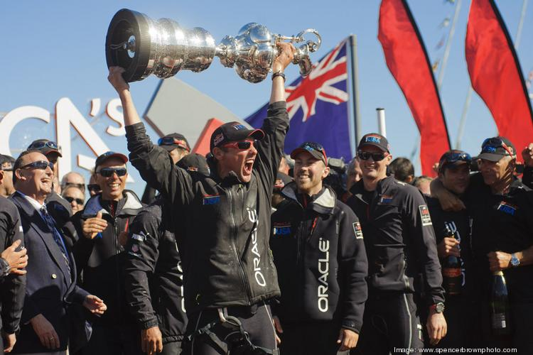 Larry Ellison, who spent an estimated $200 million defending Oracle's first America's Cup, lifts it for the second time after his Team Oracle USA won in 2013.