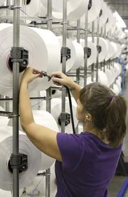 Jennifer Barringer creels REPREVE yarn at Unifi's Yadkinville plant.