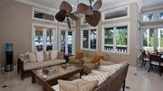 The living room features French doors facing the outdoor terrace.