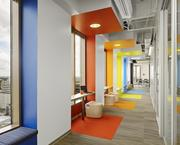 "The use of color and natural light creates a hallway of intrigue, which also features ""touchdown spaces"" for workers who have dropped in from other corporate locations."