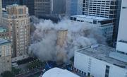 The 10-story Macy's building in downtown Houston was reduced to rubble Sunday morning, Sept. 22.