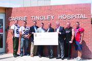 "Albuquerque Police Department and the Albuquerque Fire Department  Members of the Albuquerque Police Department and the Albuquerque Fire Department presented the Carrie Tingley Hospital Foundation with a $6,500 raised through fifth annual charity football game known as ""The Battle of the Badges,"" or the ""911 Bowl"". The Battle of the Badges, Cops vs. Firefighters football game is held annually at Milne Stadium. The firefighters won this year with a field goal bringing the final score to 13-12. Carrie Tingley Hospital Foundation is a non-profit organization that helps New Mexico families and children.  Pictured, officers from the Albuquerque Police Department (at left) present  Carrie Tingley Hospital Foundation Board Member Howie Herbert III, Foundation Director Jeff Hoehn, Board Member Mario Burgos and Board Member Dan Westbrook with a check symbolizing a $6,500 donation resulting from the ""Battle of the Badges"" game played against Albuquerque Fire Department firefighters (at right)."