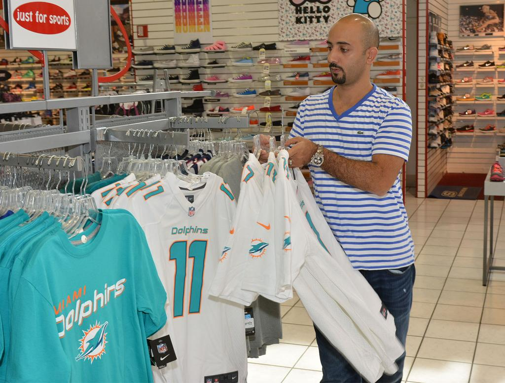 Hot Touchdown! Miami Dolphins merchandise sales are booming slideshow  for sale