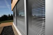 Exterior venetian blinds on Eric Lemelson's Karuna House stop sunlight from entering the house when it's not exactly needed. This is critical to Passive House-style construction in the spring and fall because the house can get too warm without the blinds.