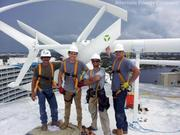 Crew from Alternate Energy Company on the roof of the Hilton Fort Lauderdale Beach Resort. From left, Ed Paparelli, Robbie Everhard, Mike Haller and Jacob Mukai.
