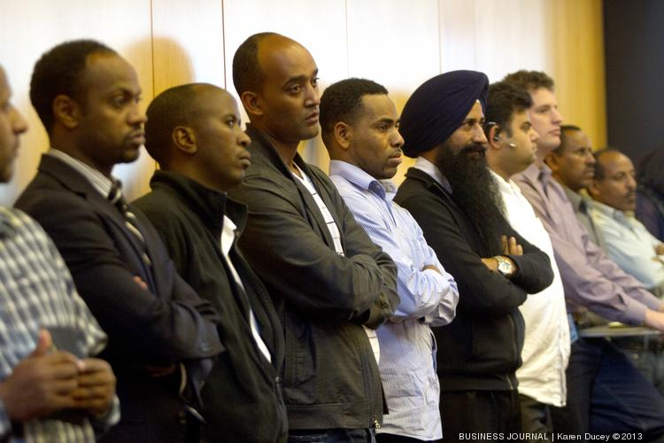 Taxicab drivers, shown here at a September 2013 meeting, want Seattle City Council to implement regulations on new, app-based ridesharing companies.