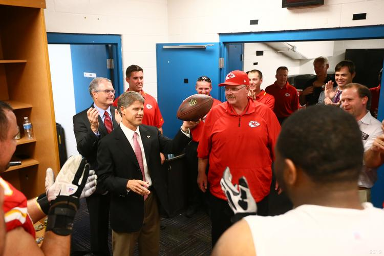 Clark Hunt gives the game ball to Head Coach Andy Reid after the 28-2 win at Jacksonville on Sept. 8. It was Reid's first victory as head coach of the Chiefs.