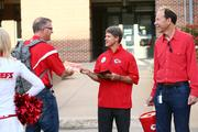 Clark Hunt joins Sprint Corp. CEO Dan Hesse selling Red Friday magazines at Sprint's headquarters in Overland Park.