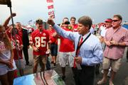 Clark Hunt leads a cheer at a tailgate before the Kansas City Chiefs' 2013 home opener against Dallas on Sept. 15.