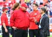 Clark Hunt talks with Head Coach Andy Reid before the Kansas City Chiefs' 2013 home opener against Dallas on Sept. 15.