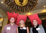 Mark Stevenson, Shanna Lee and Mike Hewitt of Southwest Search, the second-place winner in the Small Business category, are dressed for the occasion Thursday during the DBJ's 2013 Best Places to Work luncheon at the Fairmont Dallas Hotel.