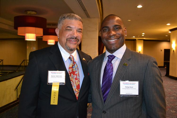 Honoree Kevin Anderson, left, director of athletics at the University of Maryland, with Philip Hunt from George Mason University at the 2013 Minority Business Leader Awards.