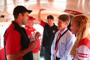 Clark Hunt visits a group of fans tailgating inside a bus before the Kansas City Chiefs home opener against Dallas on Sept. 15.