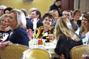 Donna Copley, Carolina Neurology & Spine Associates (at center), shares a laugh with a colleague during lunch at the CBJ Excellence in Health Care event.