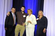 Presenters Tom Hodges and Melissa Shoemaker. Camden Sprinkle and Susan Snuggs, Carolinas Medical Center - Northeast, accept the award for Volunteer of the Year Carroll Snuggs.