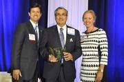 Presenters Stephen Heeseman and Cheryl Richards. Dr. Derek Raghavan, Carolinas HealthCare System Levine Cancer Institute, accepts the award for Physician of the Year.