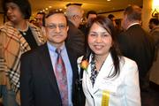 Honoree Renu Johri, right, president of Integral Consulting Services Inc., with her husband at the 2013 Minority Business Leader Awards.