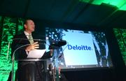 A representative from event sponsor Deloitte speaks at the podium. Afterward, honorees were called to the podium to pick up their awards.