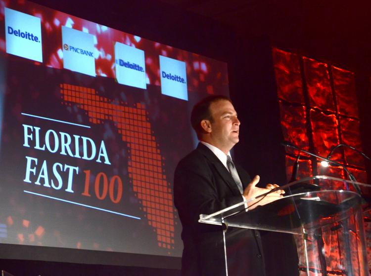 The Voice of NASCAR, Jason Alpert, welcomes the audience to the first Florida Business Journals Florida Fast 100 awards event.