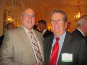 The Washington Building Congress celebrated its 75th anniversary with a Bull & Oyster Roast, held Sept. 26 at the Columbia Country Club. Todd Callaway of Bryant-Berry, left, with Mickey Villella of John J. Kirlin.