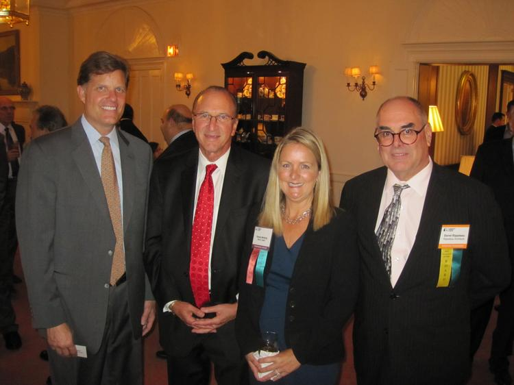The Washington Building Congress celebrated its 75th anniversary with a Bull & Oyster Roast, held Sept. 26 at the Columbia Country Club. From left, WBC President Steve Kenton, WBC Chairman-Elect Joel Zingeser, Tamara McNulty of Black & Veatch and Darrel Rippeteau of Rippeteau Architects.