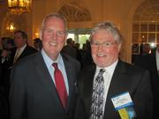 The Washington Building Congress celebrated its 75th anniversary with a Bull & Oyster Roast, held Sept. 26 at the Columbia Country Club. D.C. Councilmember Tommy Wells, left, with Jay Bothwell of Studley Capital Projects Group.