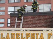 Firefighters took to the roof to help put out the fire at the station at 4th and Arch Streets in Old City.