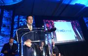 Ricky Caplin of HCI Group approaches the podium after receiving the award for fastest-growing company in Florida.