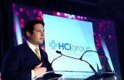 Ricky Caplin of HCI Group addresses the other attendees after receiving the award for fastest-growing company in Florida.