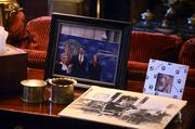 Framed pictures of Gov. McCrory and First Lady Ann (left) and Mo McCrory (right), the family dog, rest on a side table in the library.