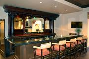 An extension of the dining room, this bar area serves as a social gathering place for residents.