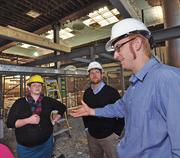 Jeff Mirel (right), president of Albany Barn Inc. and Kristen Holler, executive director, tour The Barn in Albany with Peter Gannon, president of The Arsenal Business and Technology Partnership.