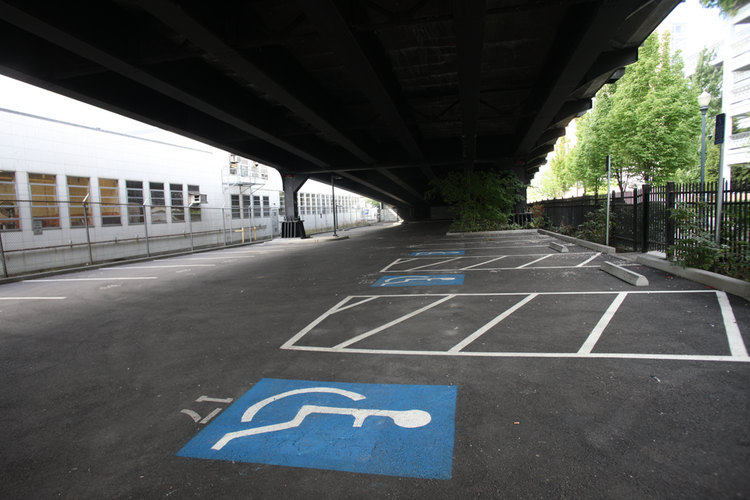 Plans to move the Right 2 Dream Too homeless camp to a parking lot under the Broadway Bridge has triggered legal proceedings against the city's development arm.
