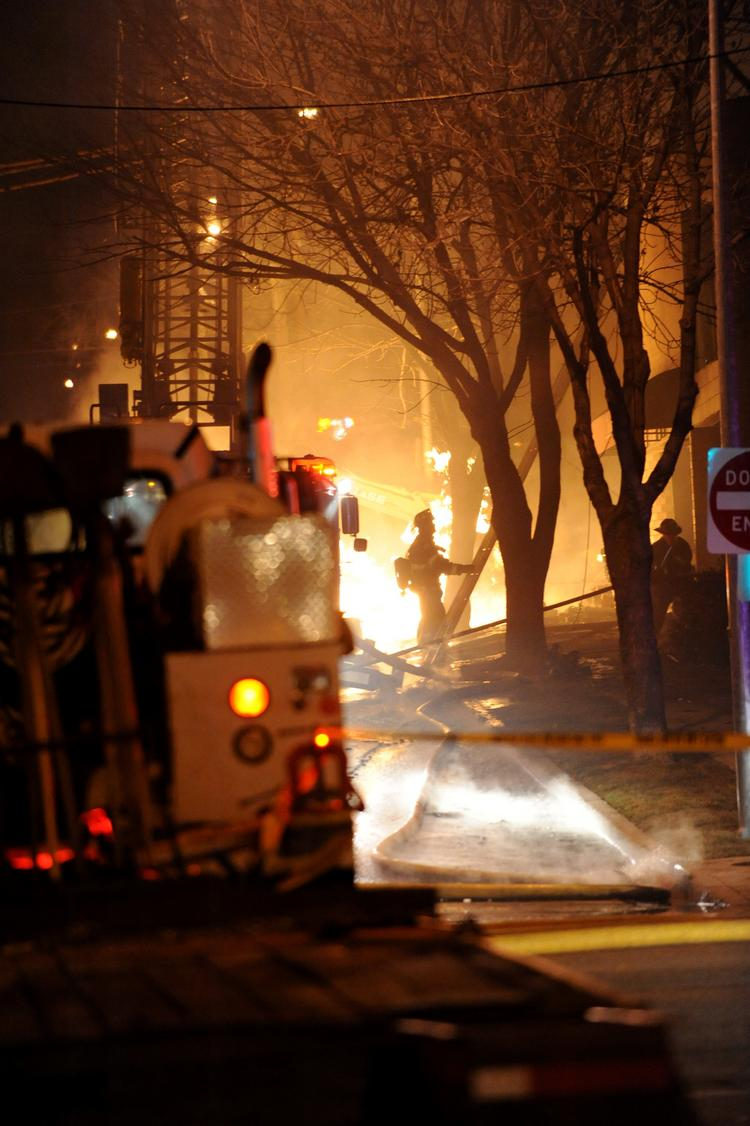 KCMO firefighters get into position to attack the blaze that destroyed JJ's Restaurant, which killed one and injured more than a dozen people following a natural gas explosion.