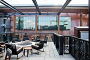 The upperdeck with a fire pit and contemporary rocking chairs overlooking the Music City Center.
