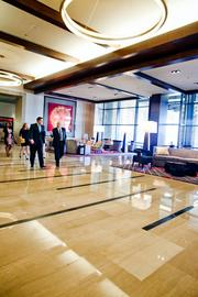 Music City Center CEO Charles Starks, left, tours the lobby during a pre-opening reception.