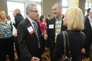 Mark Lacy (left) of Deloitte and Fred Cornwell of PlattForm Advertising attend the Kansas City Business Journal's 2013 Best Places to Work awards luncheon.