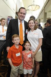 NorthPoint Development's Nathaniel Hagedorn is joined by his wife, Sarah, and children Peter (left) and Lila at the Kansas City Business Journal's 2013 Best Places to Work awards luncheon.