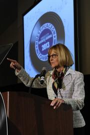 Kansas City Business Journal Publisher Joyce Hayhow makes an announcement at the 2013 Best Places to Work awards luncheon.