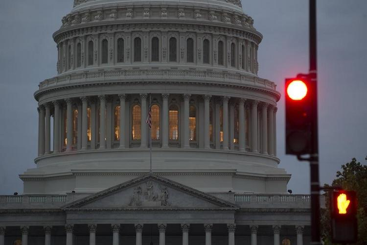 It could be lights out for the federal government Tuesday unless Congress reaches a deal on a funding bill by midnight Monday.