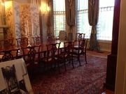 An 1800s English mahogany banquet table seats 24 in the dining room. Gov. McCrory sits at the head of the table, and his wife, Ann, sits either to his right or at the opposite head of the table.