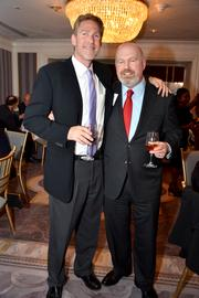 Brad Asness, chief legal officer of AQR Capital Management LLC, and Cliff Asness, co-founder of AQR Capital Management LLC., attend the Ayn Rand Institute dinner at the St. Regis Hotel in New York, U.S., on Thursday, Sept. 26 Ken Moelis, ehief executive officer of investment bank Moelis & Co., was the featured speaker for the evening.