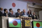 Shinzo Abe, Japan's prime minister, fourth from left, rings the closing bell at the New York Stock Exchange (NYSE) in New York,on Wednesday, Sept. 25. Abe's pledge to end 15 years of deflation and the Bank of Japan's monetary policy easing, along with Tokyo's winning bid to host the 2020 Olympic Games have helped boost consumer sentiment.