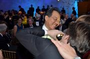 Cellist Yo-Yo Ma has his photo taken by violinist Joshua Bell at the post-concert supper of the New York Philharmonic Opening Gala in New York, on Wednesday, Sept. 25. The gala raised $2.9 million with 850 guests.