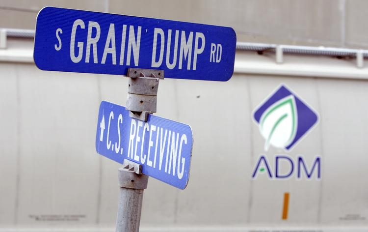 Road signs sit on the grounds of the Archer Daniels Midland headquarters in Decatur.