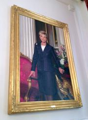Portraits of North Carolina's previous governors hang on the walls of the mansion's entrance hall.