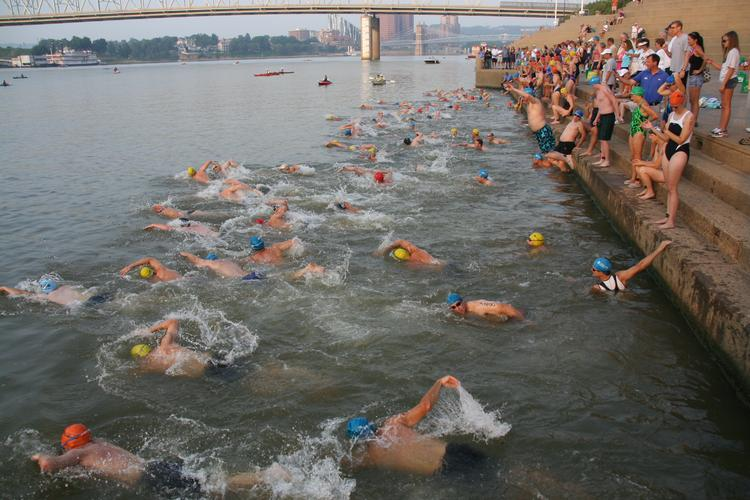More than 100 adults and teenagers completed last year's Great Ohio River Swim. Barge and motorboat traffic will be halted along Cincinnati's Serpentine Wall from 7:50 to about 9 a.m. for the event this Sunday.