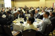 Eight Sacramento-area developers and developments won honors Friday at a breakfast event that focused as much on the future as on the past year. Here, people watch the awards.