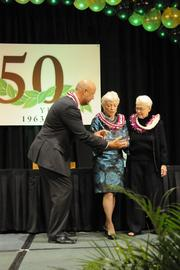 Pacific Business News Publisher Bob Charlet congratulates Jean Rolles and Pat Kelley, daughters of Outrigger Enterprises founders Roy C. and Estelle Kelley. The Kelleys were honored as the most influential business leaders in Hawaii over the past 50 years during the PBN anniversary gala at the Hilton Hawaiian Village Waikiki Resort.