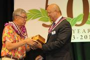 Stuart Ho received awards on behalf of his late father, Chinn Ho, and the Hawaii Newspaper Agency from Pacific Business News Publisher Bob Charlet.